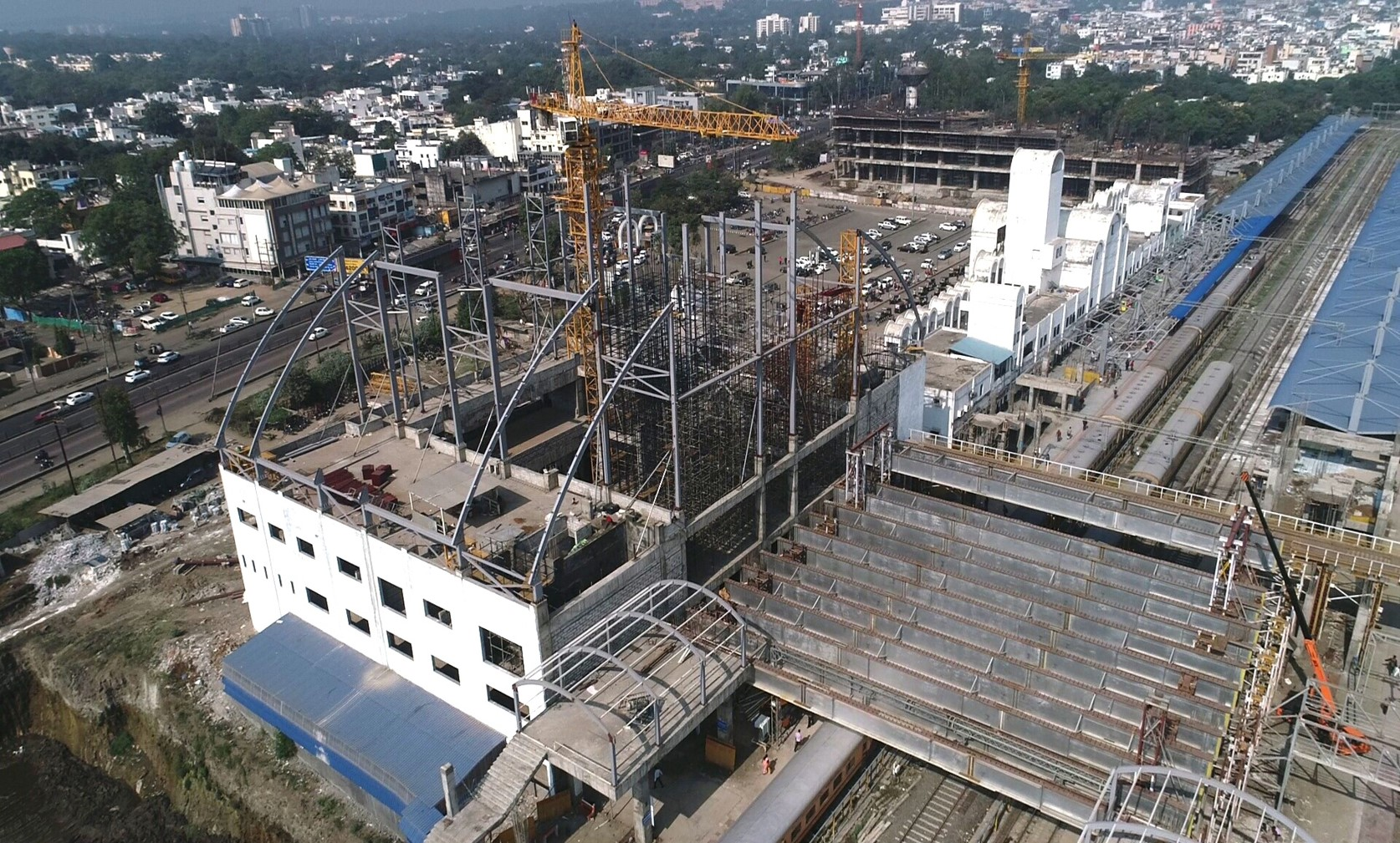 West building Dome erection, PF1 balance COP structure complete, sheeting in progress. Air concours Span 1 girder lowering in progress.  at Habibganj Railway Station