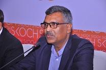 Guest is giving speech in SKOCH smart services Meeting